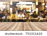 wood table with blur light... | Shutterstock . vector #751311610