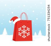 shopping bag with christmas hat ... | Shutterstock .eps vector #751334254