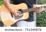 guitar with a man's hands... | Shutterstock . vector #751340878