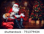 surprised santa claus in a... | Shutterstock . vector #751379434