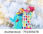 kids playing in snow. children... | Shutterstock . vector #751405678