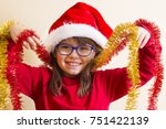 girl with christmas ribbons | Shutterstock . vector #751422139