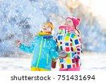 kids playing in snow. children... | Shutterstock . vector #751431694