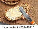 slice of bread with butter on... | Shutterstock . vector #751443910