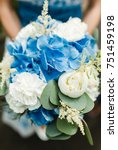 bride holding blue wedding... | Shutterstock . vector #751459198