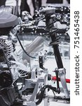 Small photo of Exposed automobile engine in motor show, contemporary transportation theme
