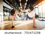 young beautiful fitness couple... | Shutterstock . vector #751471258