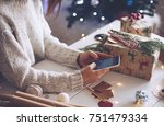 young woman preparing gifts and ... | Shutterstock . vector #751479334