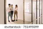 three architects looking at a... | Shutterstock . vector #751495099