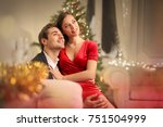 sweet couple sitting on a sofa  ...   Shutterstock . vector #751504999