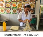 Small photo of Putatan Sabah Malaysia - Nov 8, 2017: A chinese man making fresh noodles using his bare hands. Food tourism can be regard as visitation of tourists to a place for experience the food tasting.