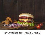 cheeseburger and onion rings on ... | Shutterstock . vector #751527559