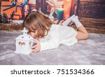 the little girl is playing with ... | Shutterstock . vector #751534366
