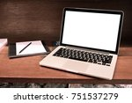laptop with blank screen on... | Shutterstock . vector #751537279