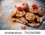 baked apples with raisin ... | Shutterstock . vector #751563580