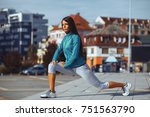 young sport woman stretching...   Shutterstock . vector #751563790