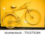 golden yellow bicycle as... | Shutterstock . vector #751575184