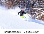 good skiing in the snowy... | Shutterstock . vector #751583224