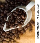 roasted coffee beans in white... | Shutterstock . vector #751609360