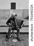 Small photo of WARSAW POLAND 09 12 17: Young Romani playing piano accordion for money. Because the poverty of the Roma in Poland they need social assistance protected for 53% of the Roma population