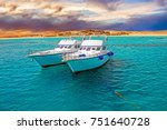 tourist white boat in sea at... | Shutterstock . vector #751640728