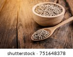 pepper in a bowl on wooden... | Shutterstock . vector #751648378