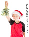 Pre-teen boy with mistletoe wanting a kiss isolated on white background - stock photo