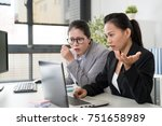 two asian business women got... | Shutterstock . vector #751658989