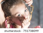 beautiful child is trying on... | Shutterstock . vector #751738099
