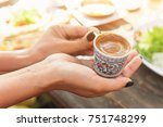Woman's Hand Holding A Cup Of...