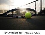 tennis ball and racket on hard... | Shutterstock . vector #751787233