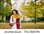 happy pregnant woman with scarf ... | Shutterstock . vector #751788598
