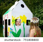 girls play with a cardboard... | Shutterstock . vector #751808800