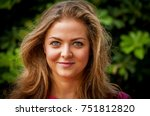 Small photo of Young and attractive Caucasian girl with a mild smile, positive character, optimistic person, confident person, confidence.