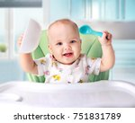 baby eating at kitchen empty... | Shutterstock . vector #751831789