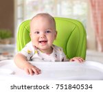 child sitting at empty table... | Shutterstock . vector #751840534