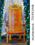 Small photo of Santa Claus chair and winter decor with native Latvian ornament