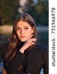 outdoor fashion portrait of...   Shutterstock . vector #751966978