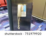 Small photo of The telephone was hanging on a pole in the airport. Used for help or inquiries.