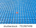 Small photo of A red seat in the middle of blue seats