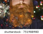 a bearded man with a decorated