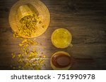 Small photo of Chrysanthemum tea and honey bee on wood background, Extend the arteries at the heart. Help prevent artery diseases such as hypertension, angina.It absorbs carcinogens and microorganisms.