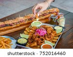 hand picking food from a meat... | Shutterstock . vector #752016460