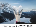 girl hiker spreading snow in... | Shutterstock . vector #752019010