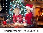 children baking christmas... | Shutterstock . vector #752030518