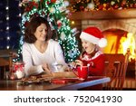 mother and daughter baking... | Shutterstock . vector #752041930