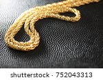 gold necklace on black leather... | Shutterstock . vector #752043313