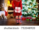 child at christmas tree and... | Shutterstock . vector #752048920