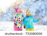 kids playing in snow. children... | Shutterstock . vector #752080000
