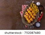 raw chicken kebab on skewers.... | Shutterstock . vector #752087680